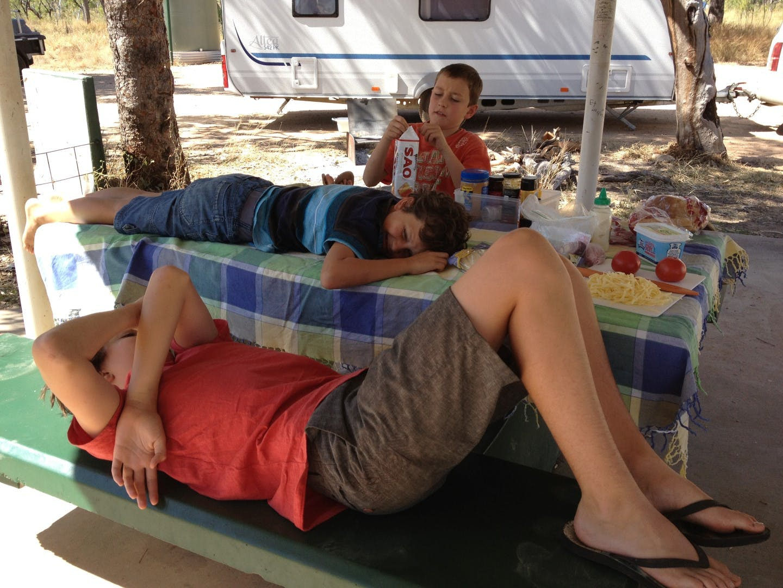 The kids enjoying a picnic