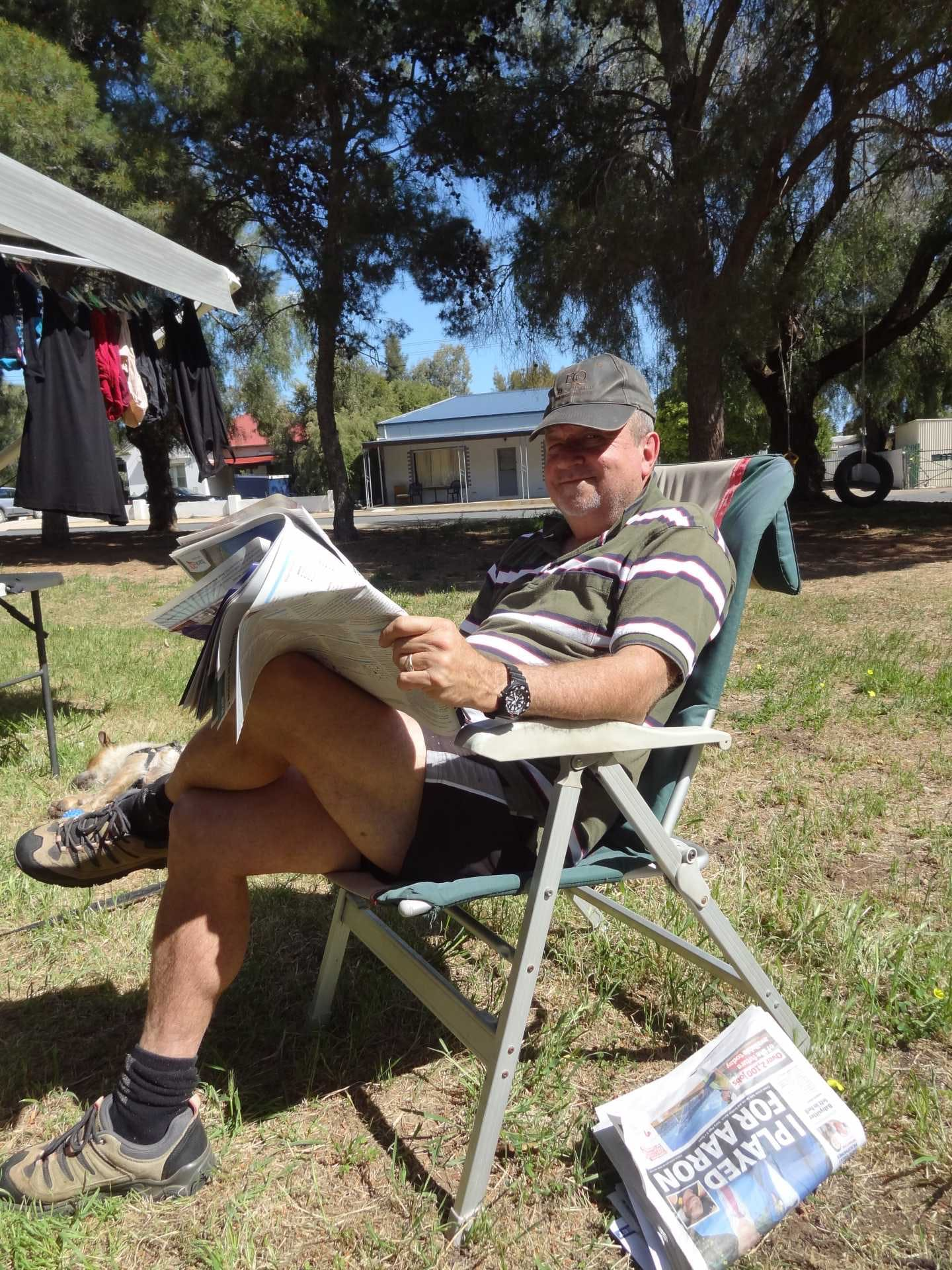 Graham relaxing with the washing reading the paper in Kittto Park - image G&J Gardiner