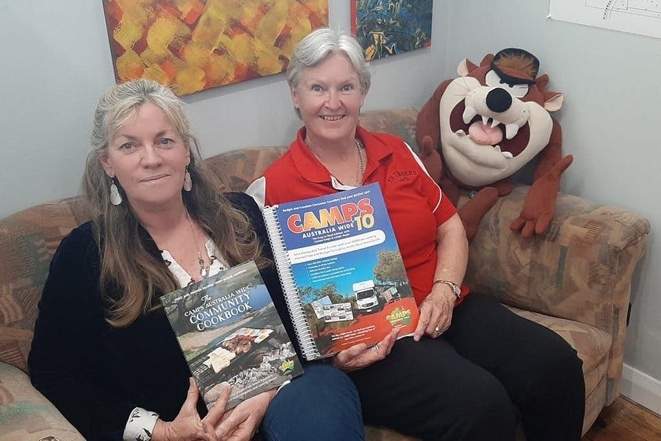Cafe Owner Angelina Hemphill (right) keeps the Camps Books to help tourists stopping in Branxholm