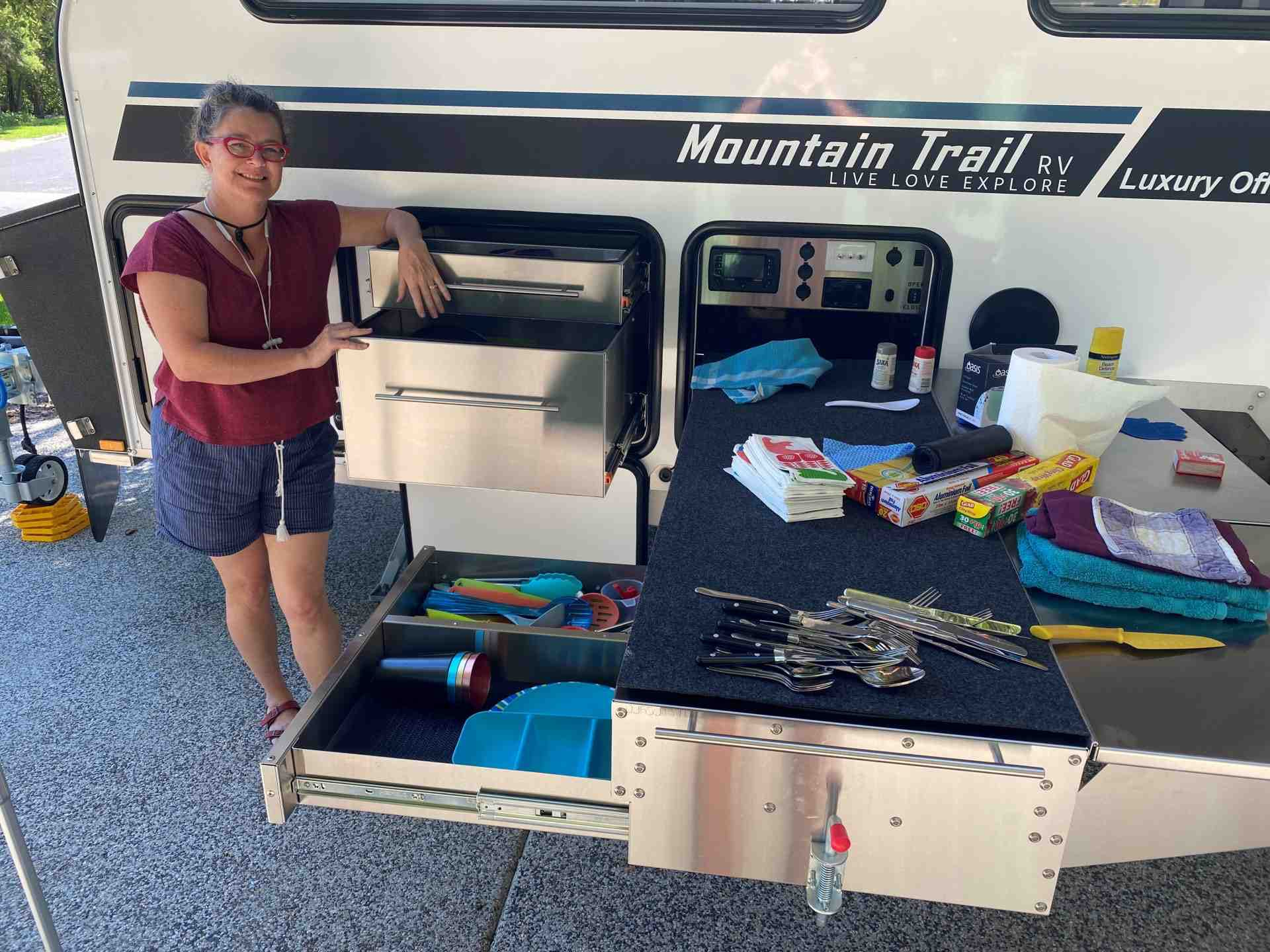 Camps Australia Wide - Michelle kitting out the new Caravan kitchen