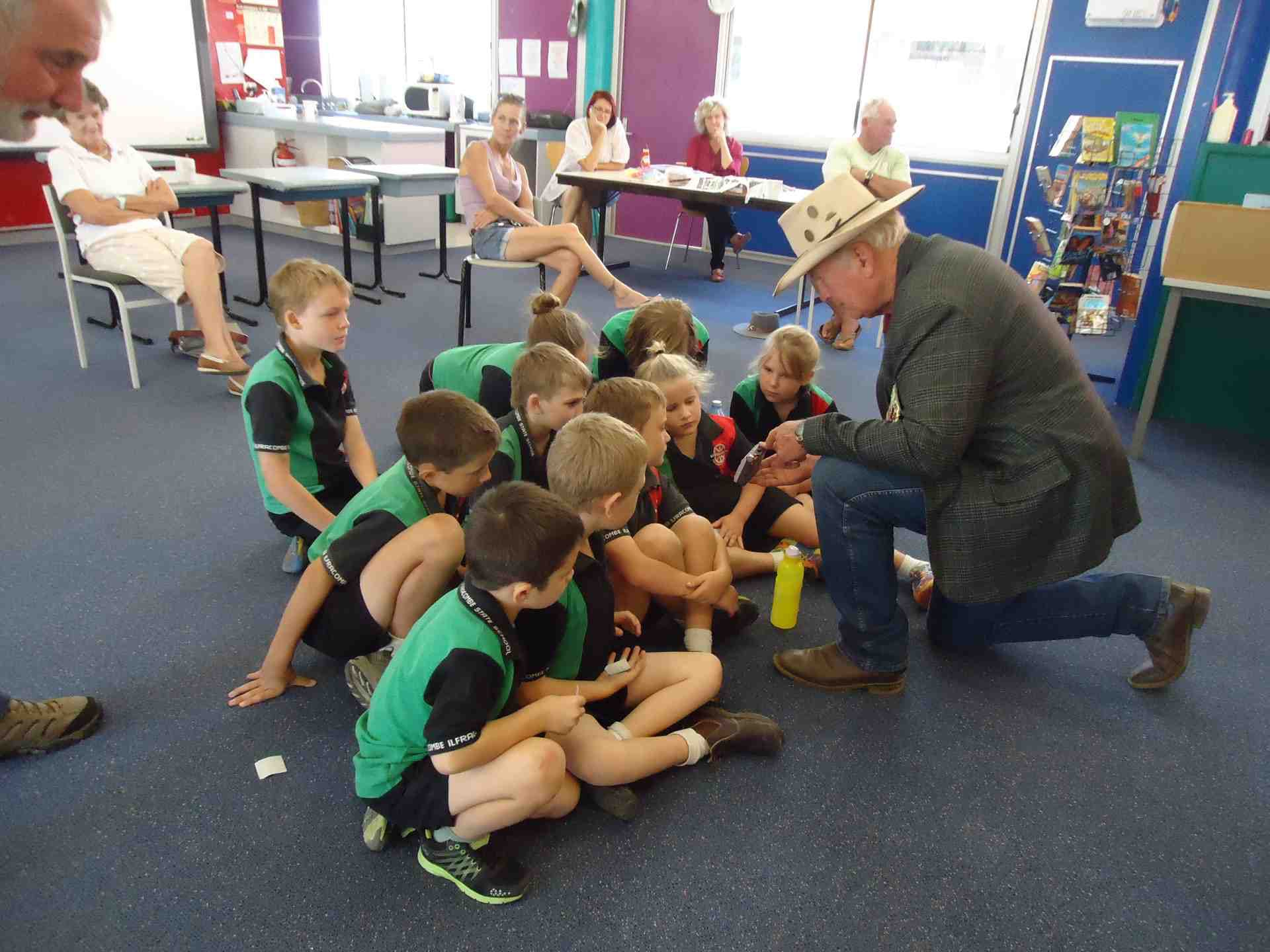 Rod explaining a piece of Anzac memorabilia to the Ilfracombe students