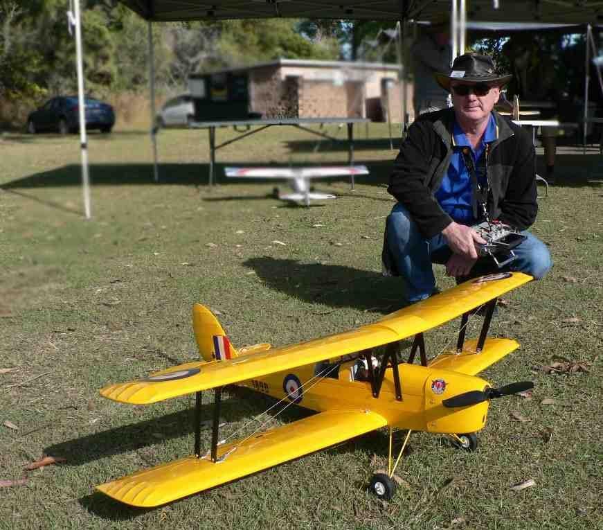 Wayne and one of his planes - de Havilland DH.82 Tiger Moth